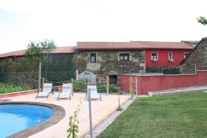 The swimming pool at or near Aldea Rural A Cortiña