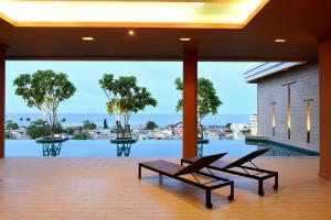 A porch or other outdoor area at Hisea Huahin Hotel