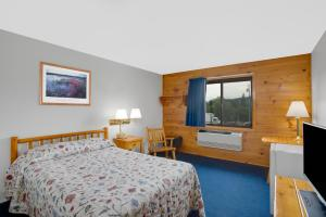 A room at Super 8 by Wyndham Lake George/Warrensburg Area