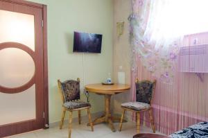 Телевизор и/или развлекательный центр в Отель Елена