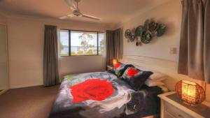 A bed or beds in a room at Dolphin Waters