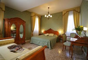 Un ou plusieurs lits dans un hébergement de l'établissement B&B Al Palazzetto