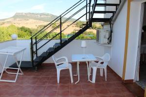 A porch or other outdoor area at Apartamentos Bolonia Paraiso