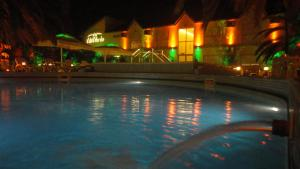 The swimming pool at or near Alto Verde Suite & Apart