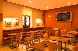 Reštaurácia alebo iné gastronomické zariadenie v ubytovaní Penzion Franko