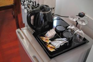 Coffee and tea making facilities at Miura Dutch Edge Hotel