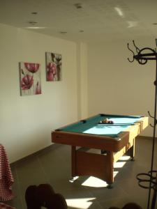 A pool table at Les Portes de la Vallee