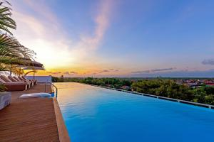 The swimming pool at or close to Infinity8 Bali