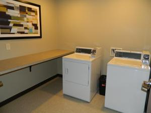 A kitchen or kitchenette at Brookstone Lodge & Suites