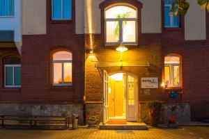 The facade or entrance of Hotel Aviv Dresden