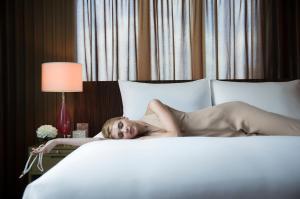 A bed or beds in a room at Sofitel Bangkok Sukhumvit