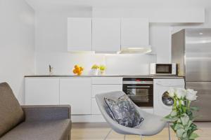 Virtuvė arba virtuvėlė apgyvendinimo įstaigoje Forenom Serviced Apartments Oslo Vika