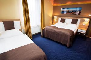 Ein Zimmer in der Unterkunft C&S Hotel