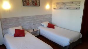 Un ou plusieurs lits dans un hébergement de l'établissement Hôtel Les Écrins
