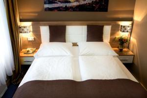 Ein Bett oder Betten in einem Zimmer der Unterkunft C&S Hotel
