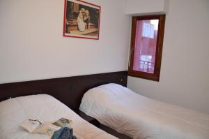 A bed or beds in a room at Le Sorgenti