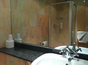 A bathroom at Mermaid Suite Hotel