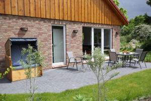 Ein Patio oder anderer Außenbereich in der Unterkunft Feriendorf Südstrand Haus 41