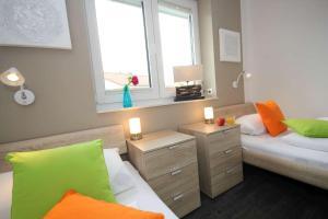 Ein Bett oder Betten in einem Zimmer der Unterkunft Feriendorf Südstrand Haus 54