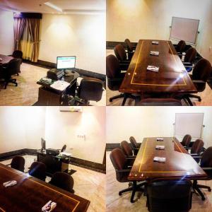 Área de negócios e/ou sala de conferências em Noor Amal Hotel Apartments As Sulay