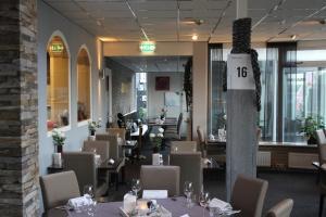 Een restaurant of ander eetgelegenheid bij Hotel Restaurant 't Klokje