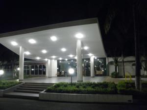A garden outside Rio Claro Plaza Hotel