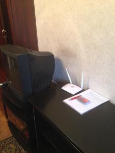 Телевизор и/или развлекательный центр в Apartment On Khoshimina 13