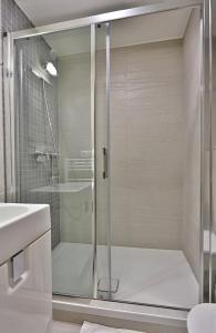 Kúpeľňa v ubytovaní Hotel Alexander