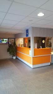 The lobby or reception area at Premiere Classe Sens Nord- Saint Clément