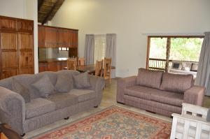 A seating area at Stoep At Steenbok Self Catering