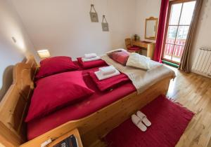 A bed or beds in a room at Apartments Mariborsko Pohorje