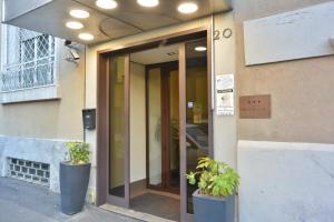 The facade or entrance of Hotel Corallo