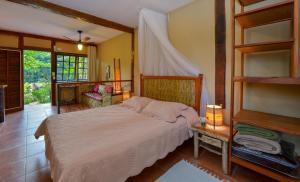 A bed or beds in a room at Pousada Villa Da Prainha