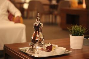 Um restaurante ou outro lugar para comer em Rafa - Al Nuzhah