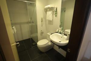A bathroom at Imperial Riverbank Hotel Kuching