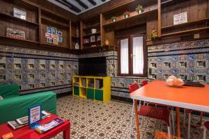 Salon ou bar de l'établissement Arc House Sevilla