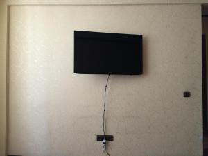 Телевизор и/или развлекательный центр в Апартаменты LUX в центре