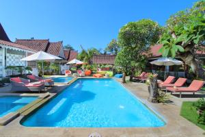 The swimming pool at or near Hotel Puri Tempo Doeloe