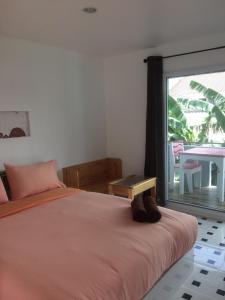 Ein Bett oder Betten in einem Zimmer der Unterkunft Toonja Kohlarn