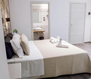 Letto o letti in una camera di Venere Rooms