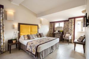 Cama ou camas em um quarto em Hotel Perseo