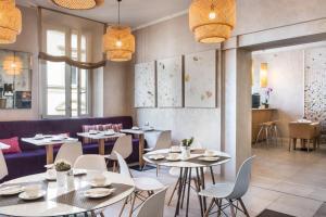 Um restaurante ou outro lugar para comer em Hotel Perseo
