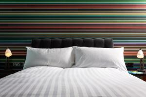 A bed or beds in a room at Village Hotel Nottingham