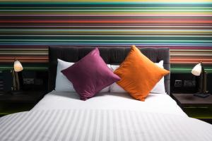 A bed or beds in a room at Village Hotel Birmingham Walsall