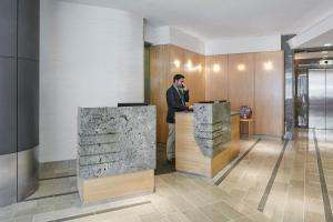 The lobby or reception area at World Center Hotel