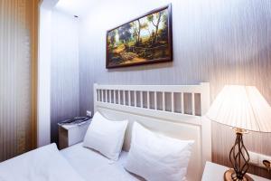 Кровать или кровати в номере Гостиница Купеческий Дом