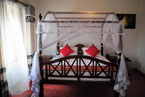 A bed or beds in a room at Miura Dutch Edge Hotel