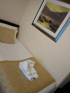 A bed or beds in a room at The Waverley Guest House