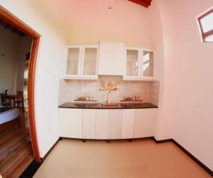 A kitchen or kitchenette at Grand Residence