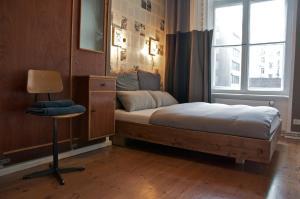 Ein Bett oder Betten in einem Zimmer der Unterkunft Linnen Luxx Apartment